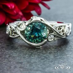Design Your Own Unique Custom Jewelry at Green Lake Jewelry Works! Custom Platinum organic wrap wave ring with fabricated filigree wires, diamond detailing and hand engraving center Montana sapphire