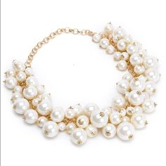 Pearl cluster choker necklace- NEW Gold tone chain with lots of white stimulated pearl beads. This is more of a choker necklace which is great for styling with a crew neck top or sweater. It's great quality and elegant! Size: 3.9 x 3.6 x 1.5 inches and 3.2 ounces in weight. Jewelry Necklaces