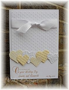 This said cuttle bug but I think you could use the hearts a flutter stampin up set and the stampin up polka dot embossing folder.