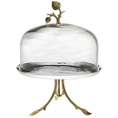 Glass cake stand with brass leaf-shaped accents. Product: Cake stand and dome Construction Material: Stainless steel, glass and brass Color: Gold and silver Features: Leaf-shaped accents Dimensions: H x Diameter Cleaning and Care: Hand wash Cake Stand With Dome, Cake Dome, Cupcake Stands, Kitchenaid, Vase Deco, Cake Pedestal, Dessert Aux Fruits, Fruit Plate, Plate Design