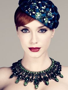 Christina Hendricks rocking her signature pale skin, and some fabulously vintage accessories.