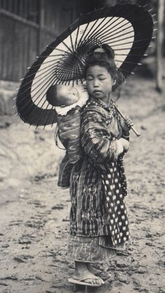 Big sister takes good care of little one. 1914-18, Japan. Image via A Davey of Flickr