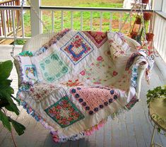 Vintage hankies quilt with a 1950's tablecloth on the back side. Ruffled hankies used to edge this quilt! Made by Cindy from Retro Revival <3