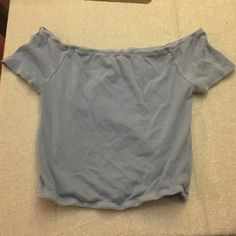 Brandy Melville crop top Baby blue off the shoulder crop top, never worn super soft!! Still scrunch at the bottom!! Brandy Melville Tops Crop Tops