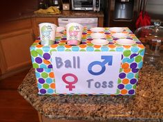 Gender reveal party game. Ball toss- toss a ball in a cup see what cup you get girl or boy!