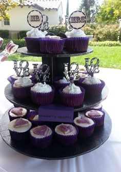 Purple themed bridal shower. Strawberry cupcake with buttercream frosting top with sugar cookies heart shaped decoration