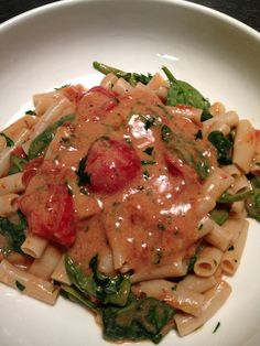 I created this rich creamy garlic sauce bursting with tomatoes and herbs to fill the void of my favorite pasta dish Rigatoni a la Vodka from my old neighborhood Italian place in Chicago.