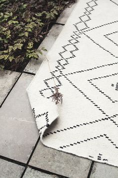 "The Koko iäksi (""For The Whole Life"") wool rug by Mum's was designed by the Finnish designer duo Saana ja Olli. Woven of off-white wool, the rug is adorned with a simple, graphic pattern in black. Rugs On Carpet, Carpets, Scandinavian Living, Carpet Design, Goods And Services, Graphic Patterns, Home Textile, Wool Rug, Home Accessories"