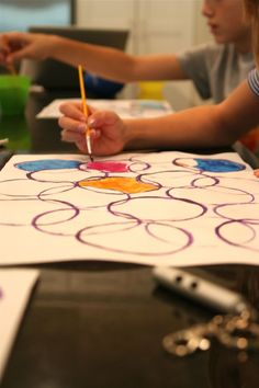 Painting circles- doing this with 1st and 2nd grade- I've been saving plastic lids for this!