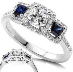 Princess cut sapphires alongside center diamond