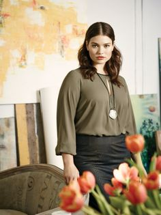 Plus size model Tara Lynn wearing a pleather trim top with a pleather crocodile pencil skirt and a snake pendant necklace. Available at Addition Elle, your plus size destination. #plussize