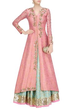 Siya Fashions Pink Jacquard Silk Lehenga Choli Online Fully stitched satin mint green anarkali suit with orange dupatta with golden tassel. Suit paired with bottom and crepe dupatta. This Suit can be customise up to plus size 56 Bust. Indian Gowns Dresses, Indian Fashion Dresses, Dress Indian Style, Indian Designer Outfits, Pakistani Dresses, Indian Outfits, Designer Dresses, Indian Attire, Indian Ethnic Wear