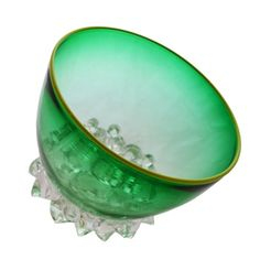 this transparent, graduated emerald green mouth blown glass bowl from the acacia collection features an electric lime rim and stunning glass feet that allows the piece to sit off-center. it's medium size and stunning shade combination make it the perfect compliment to a study or dining table alike.