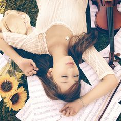 Music themed senior picture. Though I would replace the violin with a harp and change the position I was in.
