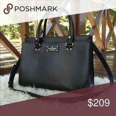 KATE SPADE DURHAM WELLESLEY BLACK SATCHEL Cowhide leather handbag with matching trim and gold toned hardware;  Top handle bag with removable adjustable strap and zip top closure; Front pocket with magnetic snap closure Dual leather handles with a drop of approx. 4.5 inches; Removable, adjustable strap with a maximum drop of approx. 22.5 inches Interior features custom Capital Kate jacquard lining, 1 zip pocket, and 2 slip pockets; Protective feet on bottom Approx. dimensions: 12.5 in L x 9…