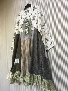 Upcycled Dusty Blue Gray and Army Green Patchwork Rose Print Jersey Tunic Dress, Tattered Boho Shabby Chic Top to wear with jeans or leggings. Size 24-28 Measured laying flat 28 Across armpit to armpit Free waist and hips 37-45 (asymmetrical Hemline)Long