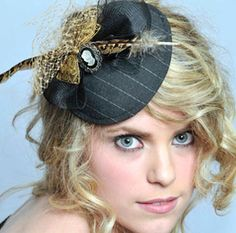 Fascinator- although...this girl's facial expression is TERRIFYING! Look at her EYES!!!
