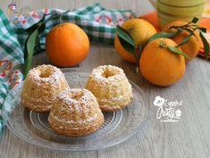 Delle profumate e golosissime ciambelline all'arancia soffici soffici, ideali per la prima colazione o la merenda con un buon tè caldo !