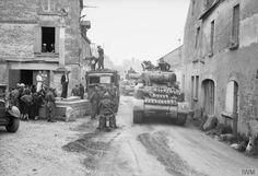 Sherman tanks of 44th RTR, 4th Armoured Brigade move through Reviers, 12 june 1944.