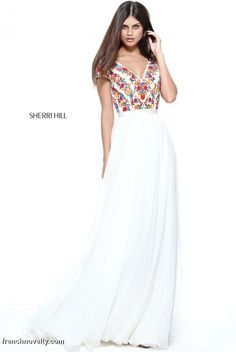 Sherri Hill 51112 is a cap sleeved prom dress with an embroidered floral bodice with lace up back and a chiffon skirt.