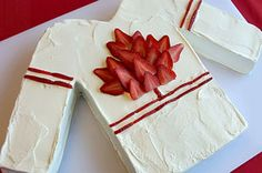 Celebrate Canada's national winter sport with our Go Canada Hockey Jersey Cake. This cake in the shape of a hockey jersey makes the perfect special occasion recipe. Sleepover Cake, Hockey Cakes, Paleo Bars, Cake Recipes, Dessert Recipes, Canada Day, Creative Food, Creative Cakes, What To Cook
