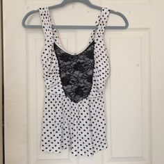 Top w/ black/white polka dots! Super cute going-out top with pretty black rose inlay and black polka dots. Very flattering on the stomach with ruched fabric on the side.  Bundle with two of my other $8 items for %20 off! (That's only $20 for 3 fabulous items!) Charlotte Russe Tops Tank Tops