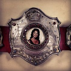 The Fabulous Moolah's Women's Championship title. Considered the longest-reigning Women's Champion having held the title for a whopping 10,170 days, The Fabulous Moolah even had her portrait added to the design! #WWE