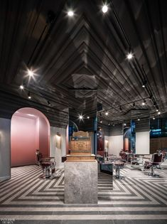 The spare, cubic volume of the reception and cash desk complements the clean-lined, modern bones of the barbershop. The marble cladding recalls a sumptuous gentleman's club. To nod at the desired throw-back vibe, Sadiku's design team, Kevin Chan and Samer Shaath, co-founders of Toronto's Nivek Remas, lined the entire ceiling, as opposed to the walls, with ornamental plaster work. Likewise, the floor, an inlaid zigzag of two-toned grey tiles, also twists tradition.