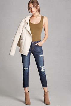 A pair of jeans featuring a distressed style, a low-rise, a five-pocket construction, and a zip fly front. This is an independent brand and not a Forever 21 branded item.