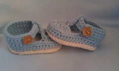 These gorgeous baby shoes are crocheted in 100% cotton , cream double soles topped with a lovely light blue upper , t bar strap and little