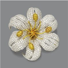 DIAMOND FLOWER BROOCH The flowerhead pavé-set with numerous round diamonds weighing approximately 14.00 carats, the center accented with gold wire stamens, four terminating in anthers pavé-set with small round diamonds of yellow hue, mounted in white and yellow gold.