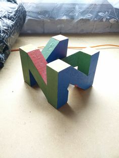 Here is my wooden N64 logo.