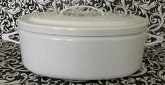 White Enamelware Cast Iron Oval Roaster with lid.  A great addition to your Vintage Country Kitchen Collection..Visit my Newly Expanded Vendor Booth, lower level at PICCADILLY 7427 156TH AVE (Highway 50 and Highway MB) Bristol, WI 53104 Tel:262-857-3509 Tues-Friday 10-6pm,Sat 10-4pm,Sun 12-4pm Monday Closed. Piccadilly is a unique shop in between the City of Kenosha and Lake Geneva in South East Wisconsin. The shop is located on Hwy 50 and Hwy MB in the Village of Bristol, WI.