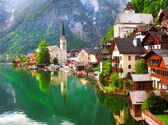 """Hallstatt, Austria.  Nope, this isn't a made-up. fairy-tale village, but it might as well be.  The Alpine town--which dates back to 800-B.C. and is nicknamed the """"pearl of Austria"""" and is the most photographed place in the country."""
