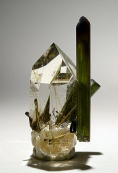 Quartz and Elbaite  Locality: Golconda Mine, Gov. Valadares, Minas Gerais, Brazil  Size: Elbaite is 0.75 inches tall and the Quartz crystal is 0.7 inches tall.