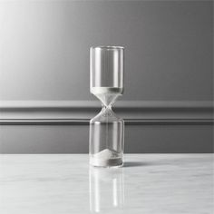 Shop 15-minute black and white hour glass.   Count down the quarter-hour as black/white sand travels through a stacked cylindrical sculpture, handmade of chem lab beaker glass.