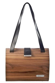 """Handcrafted using only natural wood and veneer products from the sustainable timber industry and a high quality leather lining, this one-of-a-kind wood and leather bag is surprisingly light. Magnetic clasp. Designed for everyday use, this bag features a leaf shaped glossy end to compliment the natural wood grains.    Measurements (H x W x D) 210mm x 260mm x 130mm Weight 730 g / 8.2"""" x 10.2"""" x 5.1""""   Natural Wood Bag by Nussbag. Bags - Satchel Canada"""