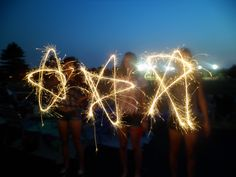 This is so cool for the 4th of July. Use sparklers to write words or drawings and take a picture! turns out great(: