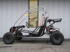 This Baja REACTION 150 go kart is powered by a 10HP 150cc four-cycle electric start engine with a variable-ratio CVT transmission (with built-in reverse), front and rear hydraulic disc brakes, and full suspension. This vehicle has been stored outside for several months and is showing some signs of weathering. However, it was recently serviced and is in good mechanical condition.
