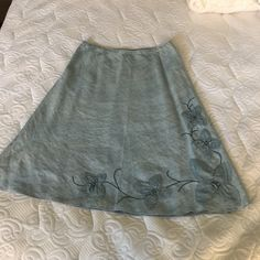 "J.Jill A line chambray colored blue linen skirt. Flowered appliqué linen skirt, 26"" Long x 32"" waist with hidden zipper. Size medium petite, machine wash, hang to dry and light iron. A nice skirt for summer. Slight light stain on middle of skirt, you can barely see in third picture. Not very noticeable. J. Jill Skirts A-Line or Full"