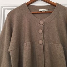 Banana Republic 100% Cashmere Sweater Softest 100% cashmere Banana Republic sweater. Swing cropped style with 3 covered buttons at top, 3/4 full bell sleeves, great detailing. Adorable and cozy! 2 small holes on side seam and lower back need to be repaired. size tag cut out but fits medium. Banana Republic Sweaters