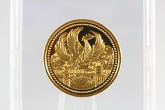 Gold Japanese commemorative coin.