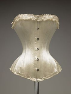 "Wedding corset Manufacturer: Royal Worcester Date: 1898 Media: Silk Satin, Lace, Whale Bone, Metal Country: United States Accession Number: 1985.40.16c A white silk satin corset with slot and stud front closure, back lacing, and embroidered satin edging and lace trim. ""Royal Worcester, WCC Style 624. Patented August 1893 and 1894"" This model of Royal Worcester corset sold at the time for $1.00 to $3.00."
