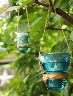 Twine-wrapped glass insulator hanging luminarias.