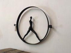"Modern Man in A Circle   Industrial Wall Art   34"" Wide x 29"" High   $395  Utopia Antiques Dealer #444  Lucas Street Antique Mall 2023 Lucas... Industrial Chic, Modern Man, Candle Sconces, Mall, Wall Lights, Elephant, Wall Art, Antiques, Street"
