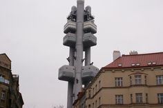 Žižkov tv tower featuring climbing baby statues by David Cerny.