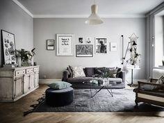 Pour la cuisine, un papier peint et des accessoires noir et blanc avec des meubles mastic.   Pour le salon, des gravures noir et blanc, un...