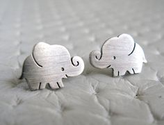 So cute! Elephant Earrings Studs- Sterling Silver. $25.00, via Etsy.