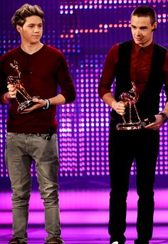 With their Bambis! LOL look Niall has his microphone in his pocket XD          So so so sexy going to die if i dont here their voices righ now