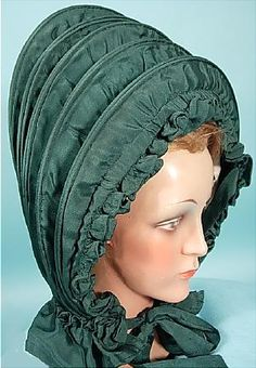 """c. late 1700's, 18th Century Calash Bonnet of Green Silk! I've read that most calash bonnets were formed of green silk, though I can't tell you why!  I have seen black, blue and tan, but green seems to be the norm.  They are rare to find outside of museums, but you can find them now and then... but RARELY if EVER do you find them in this amazing condition!  It's almost like new!!  I can't find anything to mention other than two tiny tears in the ivory lining."""